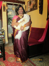 Housekeeper  Miss Sabina.Dias with cat Matahari.