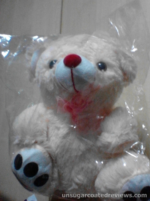 teddy bear wrapped in plastic