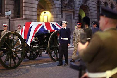A flag-draped coffin is carried on a gun carriage past St Clement Danes Church during a rehearsal for the funeral of former British prime minister Margaret Thatcher in London. Picture: Getty Image