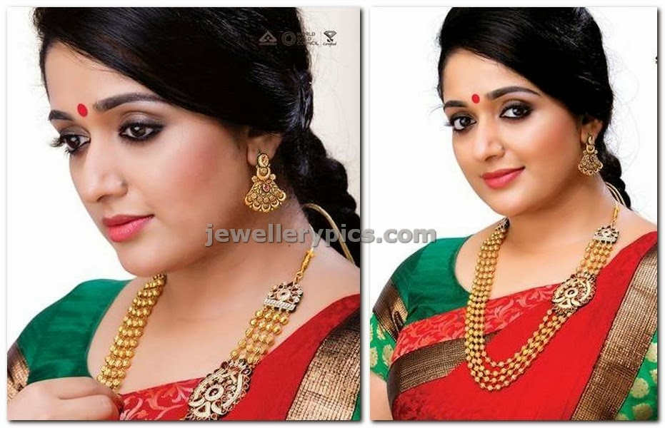 dubai gold and diamonds ad kavya madhavan showcasing gold gundla mala