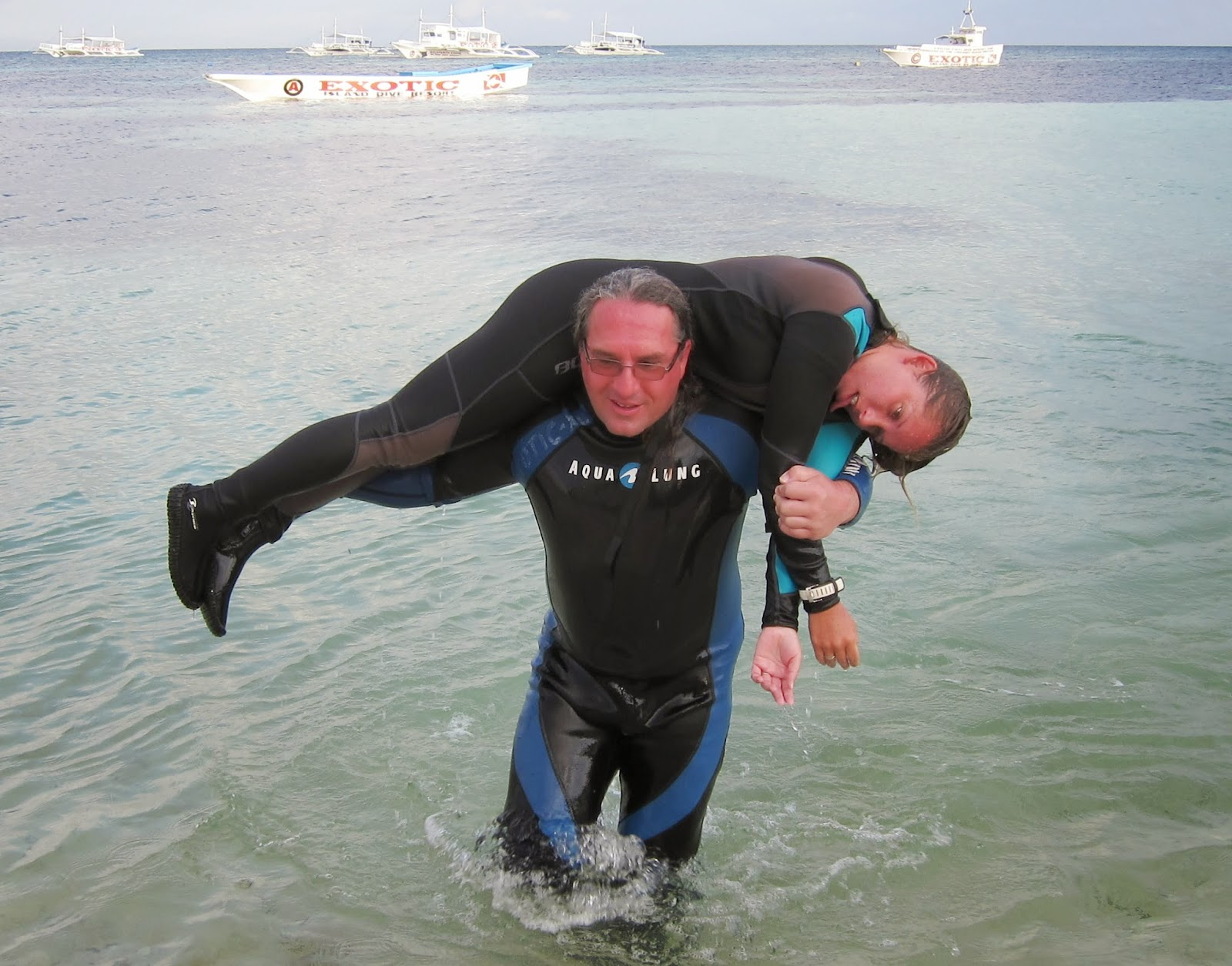 Manfred, PADI rescue diver student carries victim from the water in Malapascua Philippines
