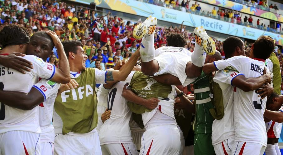 Costa Rican players celebrate after Bryan Ruiz scored his side's first goal during the group D World Cup soccer match between Italy and Costa Rica at the Arena Pernambuco in Recife, Brazil, Friday, June 20, 2014.