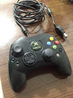 http://produto.mercadolivre.com.br/MLB-680842746-controle-original-para-xbox-classico-_JM