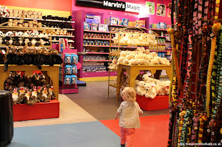 Toddler running around in Hamleys toy shop