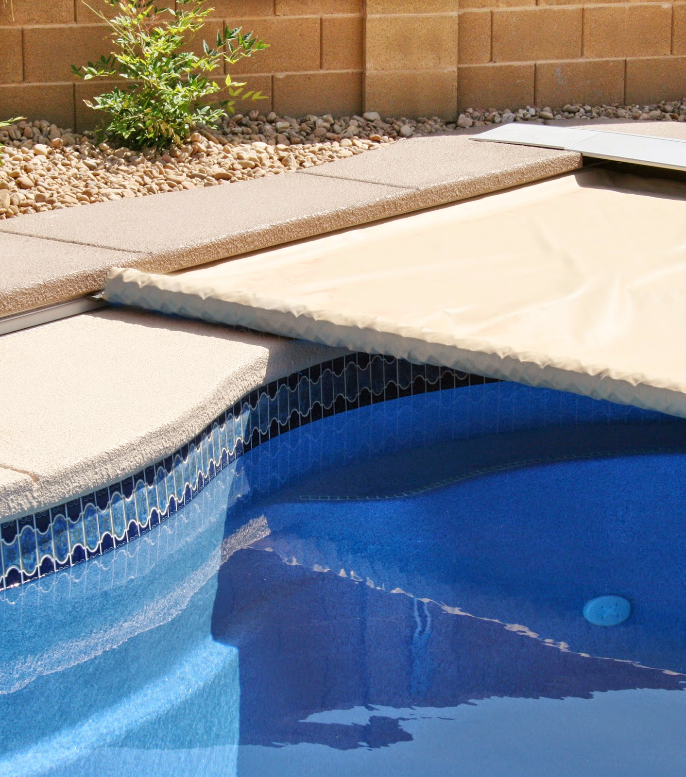 Coverstar safety swimming pool covers for automatic and solid mesh coverstar featured for Automatic swimming pool covers