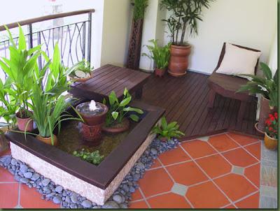 Varanda decorada com jardim e pedras
