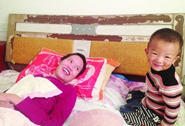 They delivered Gao Qianbo in 2011, who has stayed at her bedside since