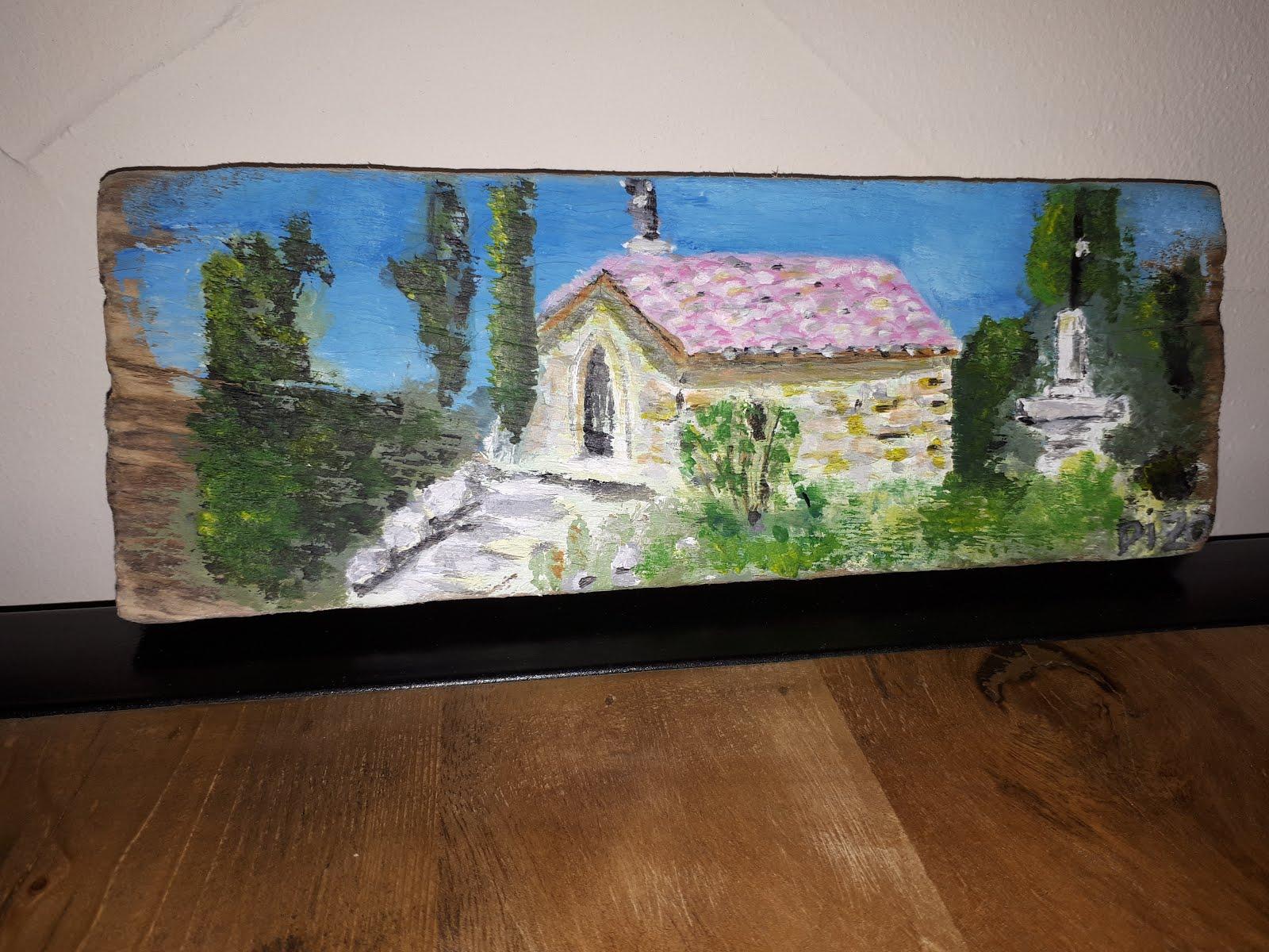 Peinture sur une planche bois flotté.