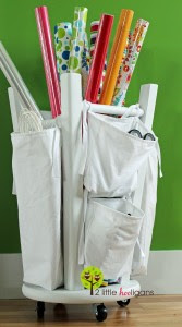 Stool turned upside down for gift wrap organizer :: OrganizingMadeFun.com