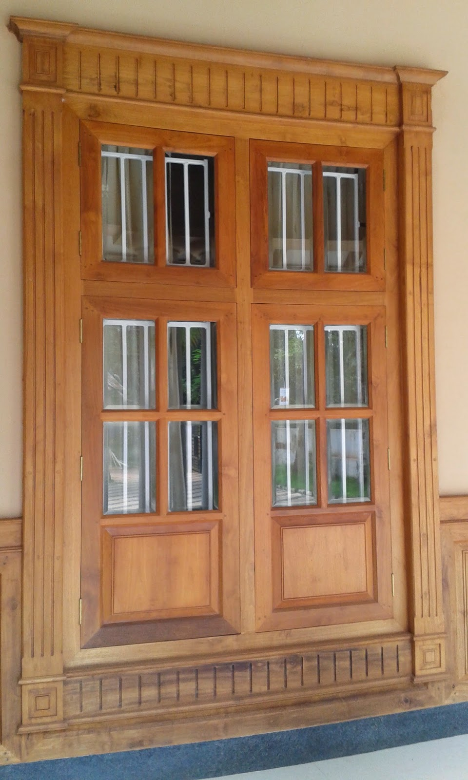 Kerala style carpenter works and designs may 2015 for Wood window door design