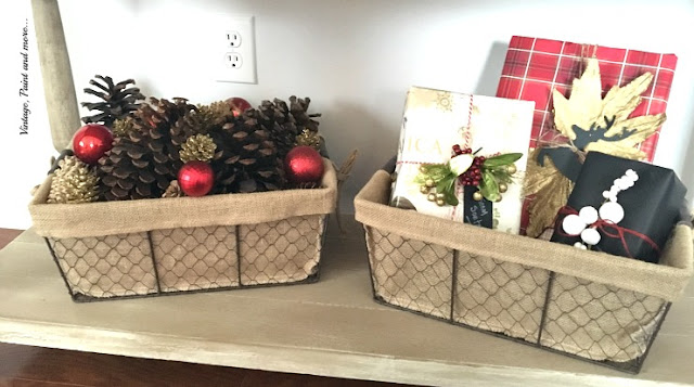 vintage industrial wire baskets with burlap liners filled with pinecones and faux packages