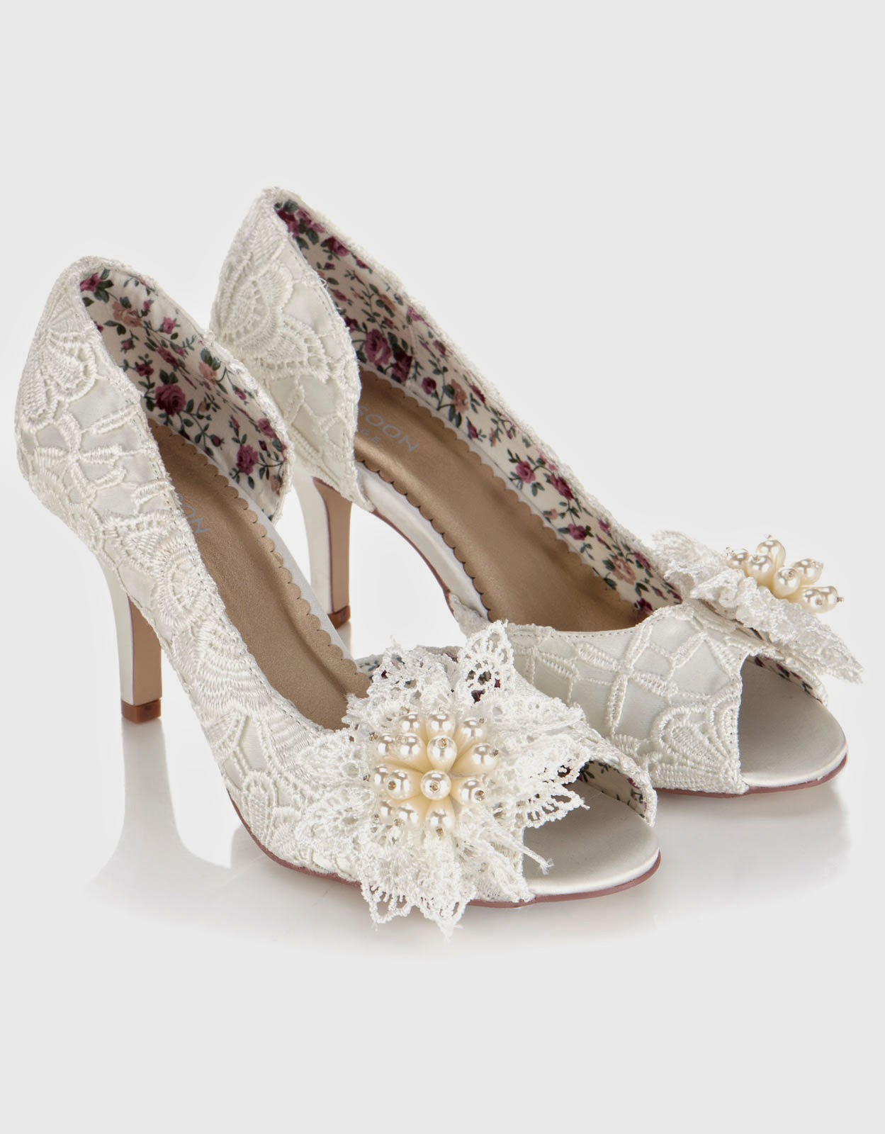Beautiful and unique handmade vintage ivory lace wedding shoes. With a comfortable low kitten heel and rounded toe, 'Lydia Elliot' is the perfect pair of bridal shoes for Brides seeking both elegance and comfort. Designed in England with Fast Worldwide Shipping.