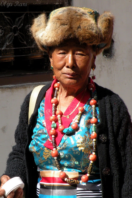 Tibetan woman wearing dzi beads, coral and turquoise necklaces