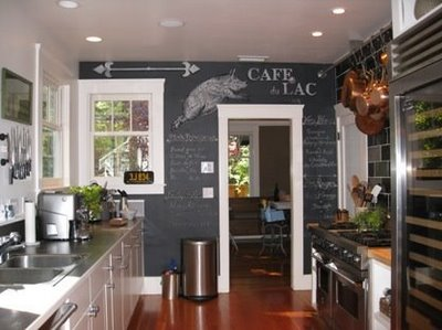 after a little google image search i was completely blown away by the use of chalkboard paint on walls especially in kitchens like these