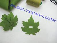 Dùng kéo cắt 1 đường ngang nhỏ trên chiếc lá còn lại để luồn chiếc cặp qua - Teenvi Blog