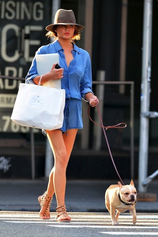 Chrissy Teigen - Denim Playsuit, Felt Fedora, Studded Flat Sandals