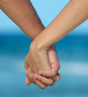 two hands clasped like lovers