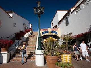 An outdoor staircase at shopping center Paseo Nuevo is decorated with Mexican tiles.