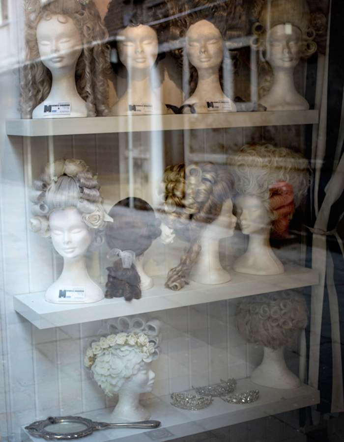 Rococo wigs in the window photo by Kreetta Järvenpää www.gretchengretchen.com