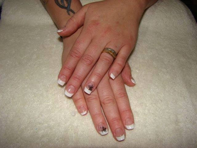 Acrylics LED polish manicure french white acrylics and stamping pearls and stamping french white acrylics LED polish removal acrylic extensions black color over application and reflector gold haze sculpted pinky nail acrylics gold pearl applications glitz and striping tape butterfly nail art purple stone feats manicure design