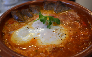 baked eggs on Spanish rice