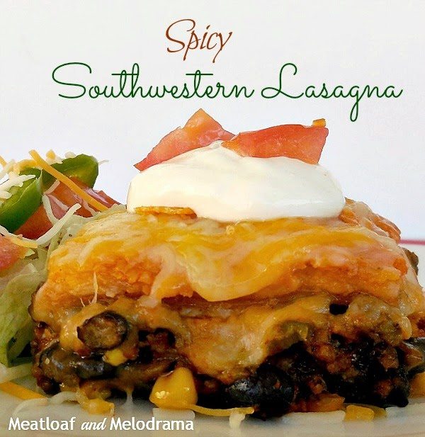 layered casserole with tortillas meat black beans and corn on a dish with sour cream