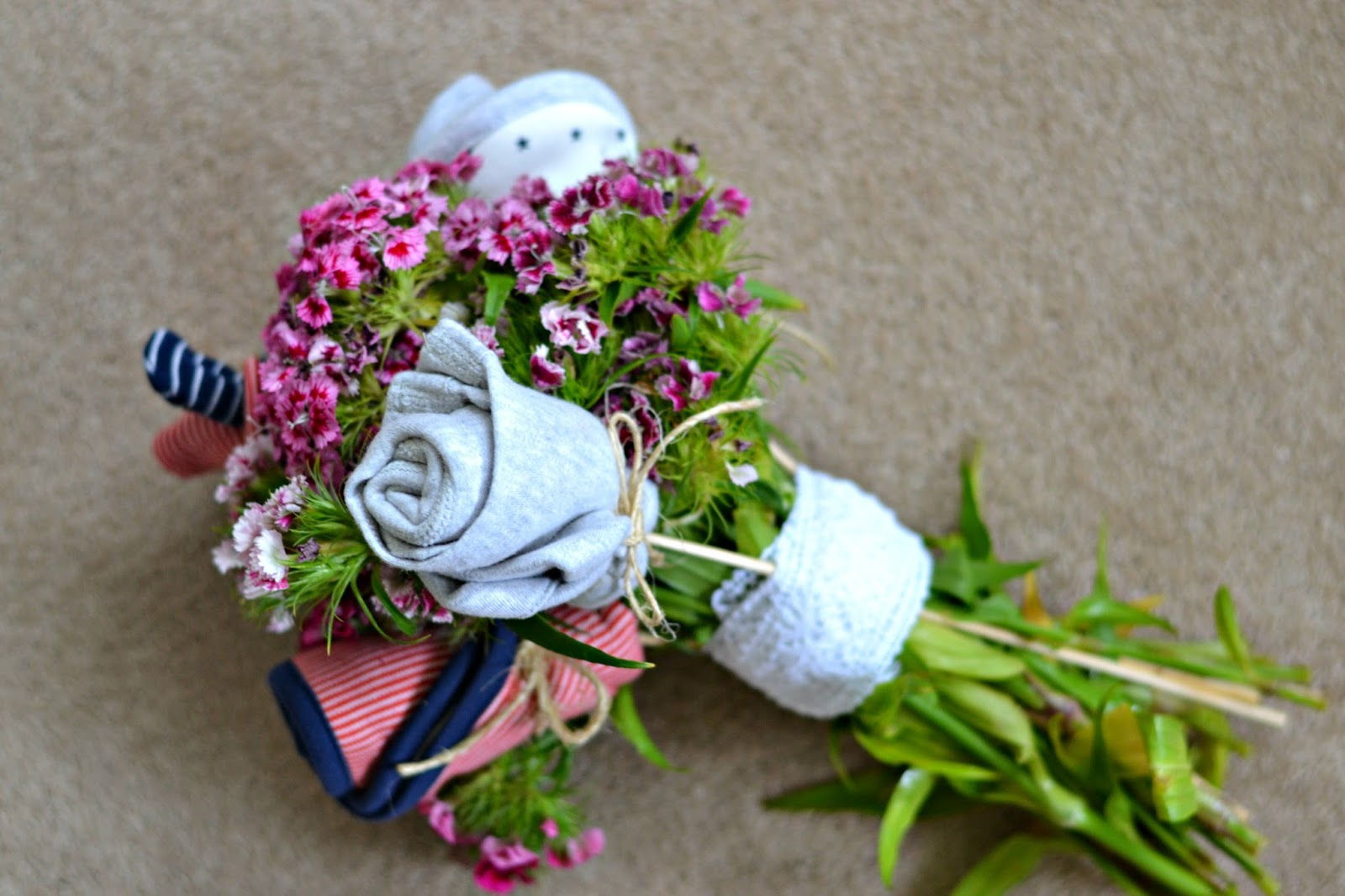 How to make a baby bouquet write like no ones watching you can view ms baby bouquet tutorial as well as their gorgeous newborn starter sets for more inspiration it certainly makes a change to a traditional negle Gallery