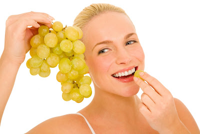 woman and grapes