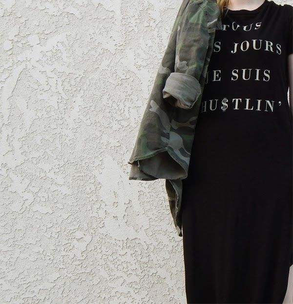 Black maxi dress styled with camo jacket.