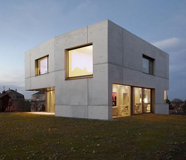 Casa minimalista con fachada en cemento todo sobre fachadas for Mini casa minimalista
