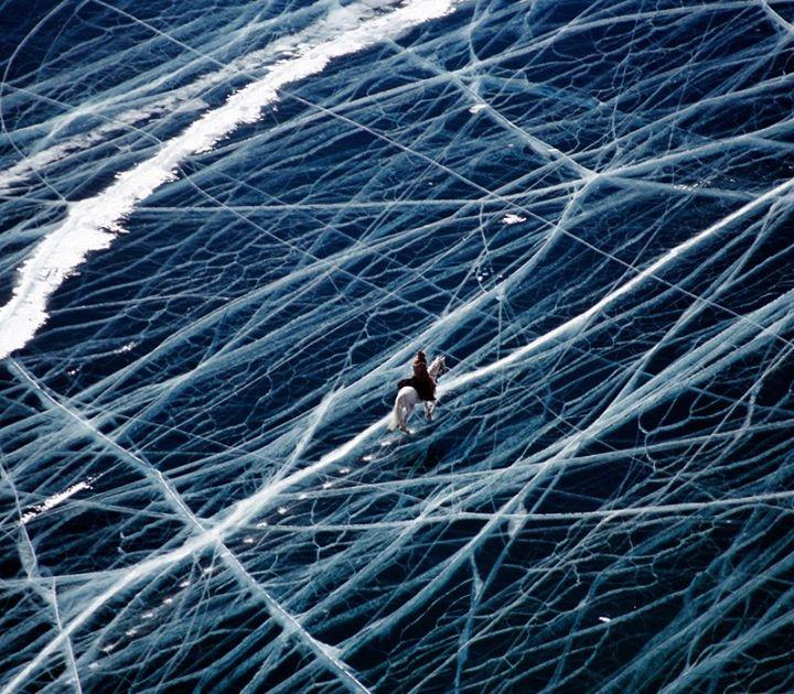 a hourse is crossing frozen lake