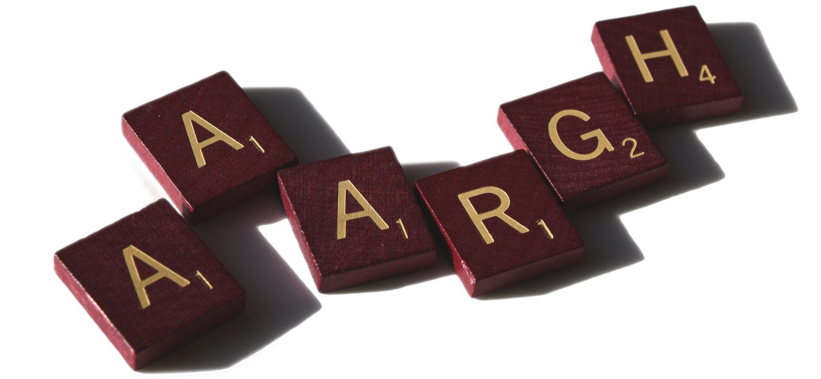 "Scrabble letters spelling out ""Aaargh"""