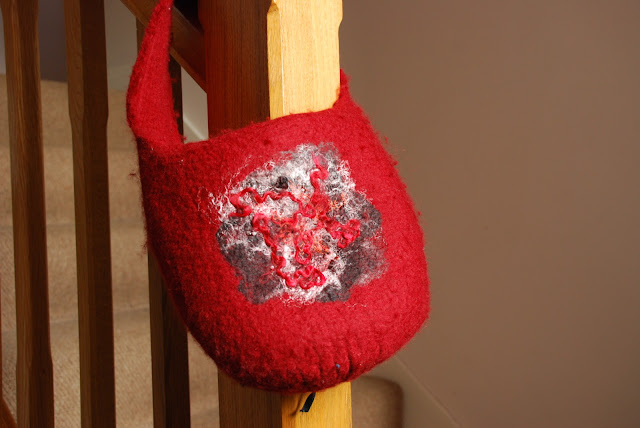 image of handmade red felt bag
