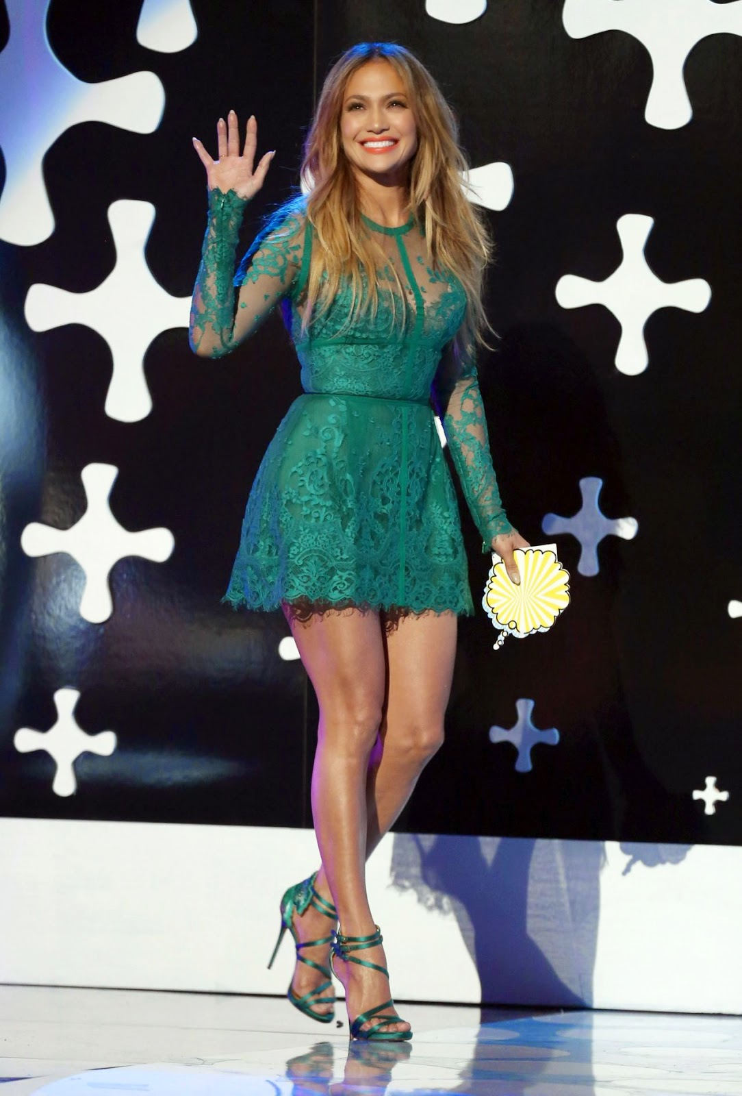 Jennifer Lopez in a green lace Elie Saab mini dress at the 2014 Teen Choice Awards