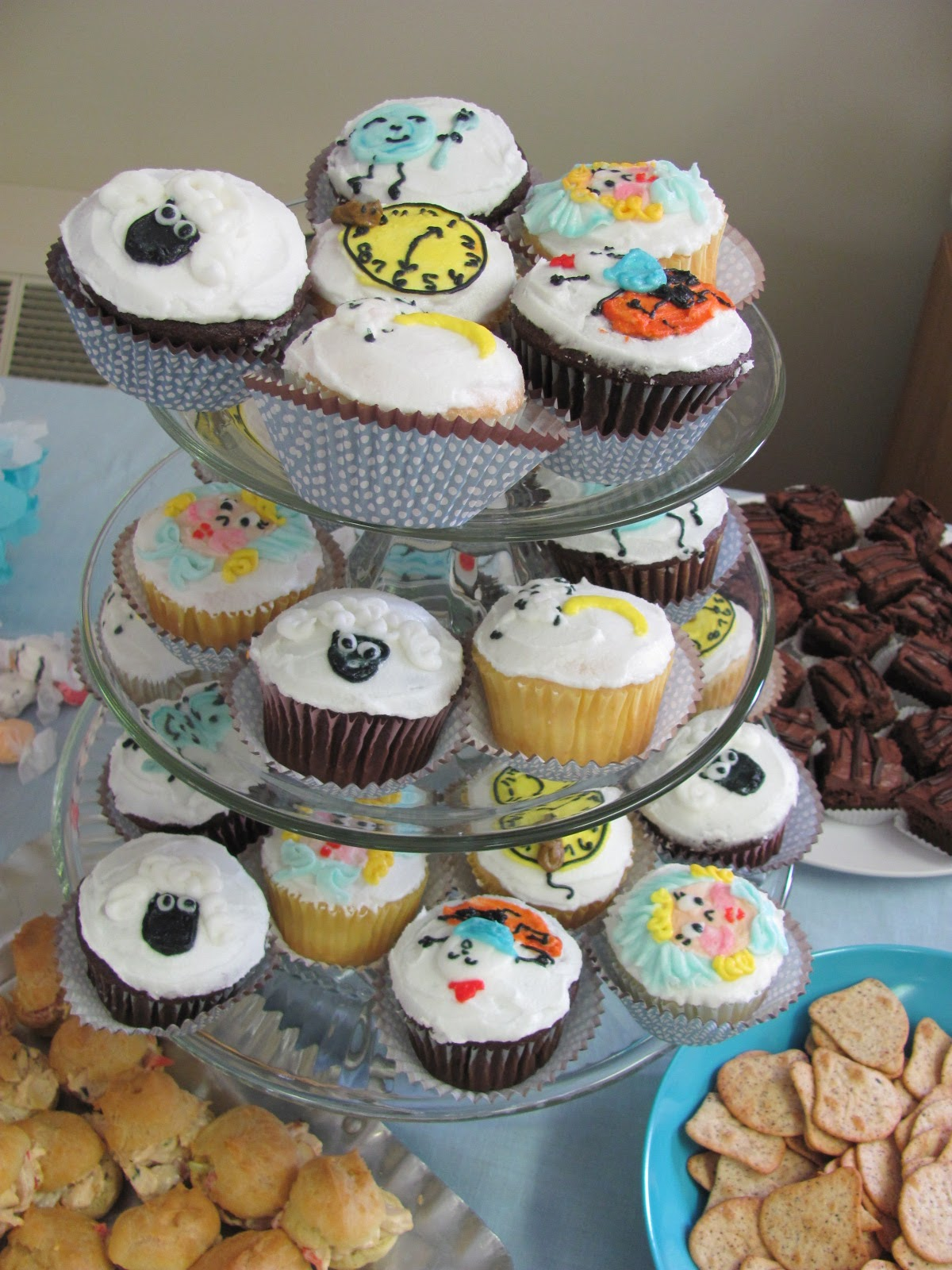 nursery rhyme characters have been frosted onto the cupcakes!