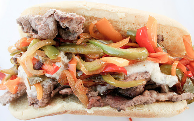 Philly Cheese Steak Sandwich with Provolone Sauce