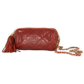 Vintage 1990's red lizard skin Chanel tootsie bag with large side tassel and gold chain strap.