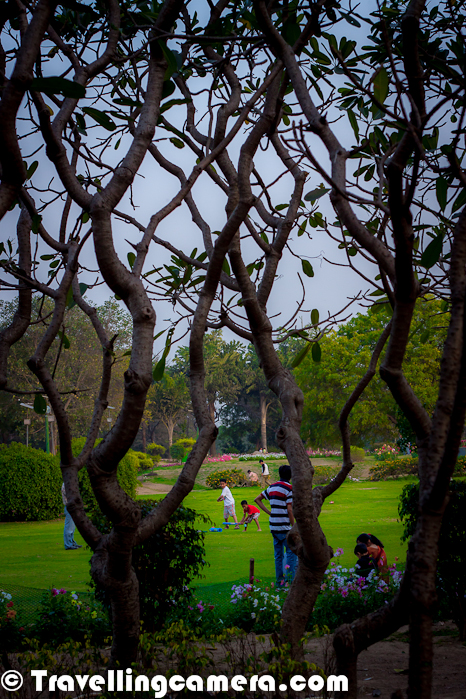 Nehru Park in South Delhi, is large park situated in the Chanakyapuri Diplomatic Enclave of New Delhi. This park is actually named after India's first Prime Minister, Pandit Jawaharlal Nehru. It's a beautiful place which is again quite popular among young couples during the day time. Let's have a quick Photo Journey from Nehru Place in Capital City of India.  Nehru Park is spread over an area of 80 acres and very close to the heart of the city... This is one of the beautiful parks in Delhi and very well maintained. Personally I love the way, it's created. There are various types of trees planted in different parts of the park and there are some beautiful elevations for kids to have more fun.The day when we visited the park, Delhi Jazz festival was going on and there was good security around the place. Some of the photographs from Delhi Jazz Festival 2012 at Nehru place can be checked at - http://phototravelings.blogspot.com/2012/03/delhi-jazz-festival-2012-by-indian.htmlDifferent types of people come to Nehru park with different motives - Joggers in morning, children to have some fun with their friends, Families for Picnic or general chit-chat, groups of school going kids to play different games etc. Many of the photographs in this Photo Journey are showing the way people spend some time at Nehru Park. Since most of the photographs are shot in evening, we are missing joggers and couples here.Cricket is something that can be experiences anywhere and everyday in India. Here is the moment of the day when we saw various groups playing cricket at Nehru Park.The park is one of the most famous landmarks of Delhi and a beautiful place to hang out during a sunny winter afternoon in Delhi. The pool, however, is not public anymore as it has transformed into a club exclusively for civil servants and their familiesNehru Park can be seen fully crowded with lots of groups with Picnic boxes with sporty environment all overNehru Park is on Panchsheel Mark and just in front of Ashoka Hotel in Chankyapuri Diplomatic Enclave regionThe Nehru Park has a beautiful collection of flowers, alluring little mounds and rocks emblazoned with the famous sayings of Nehru. Thus the park attracts people of all ages. Due to the pleasing and calm ambiance prevalent in the park, it has in recent times become popular with picnic goers as well as the young couples.The best part was that we really liked the way it was maintained. Quite clean and well maintained. Usually colors don't like these in India :)