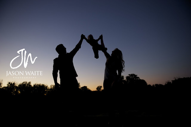 a family of three silhouette at river legacy park