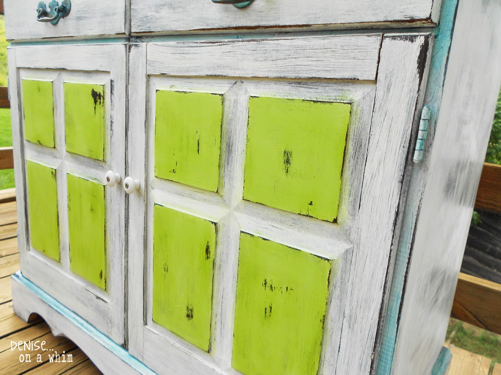 A wet rag worked great for distressing these cupboard doors by Denise On a Whim