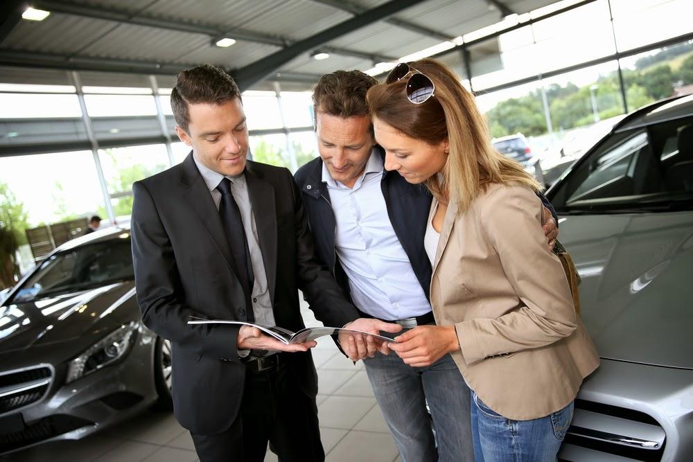 couple at car dealership in NJ