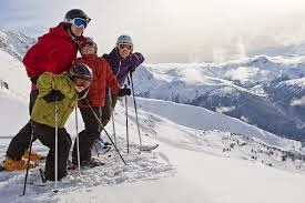 family of four getting ready to ski downhill