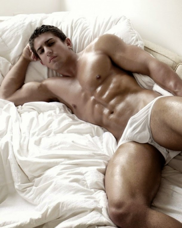 Muscular Man Waking Up in Bed