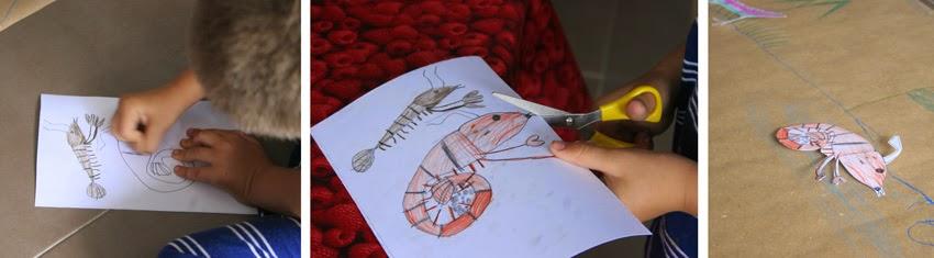 Pintando los peces en en cartulina para el juego de pesca