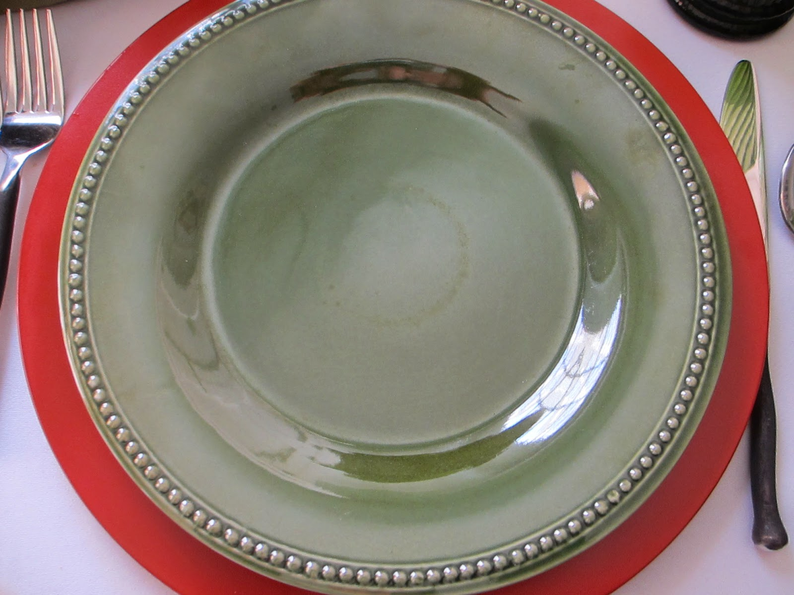 The dark olive green dinner plate is  Spice Route  Clove from Pier 1 & Table for One: August 2014