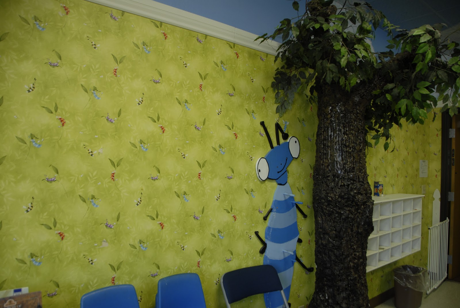 Blue chairs and blue bug in classroom