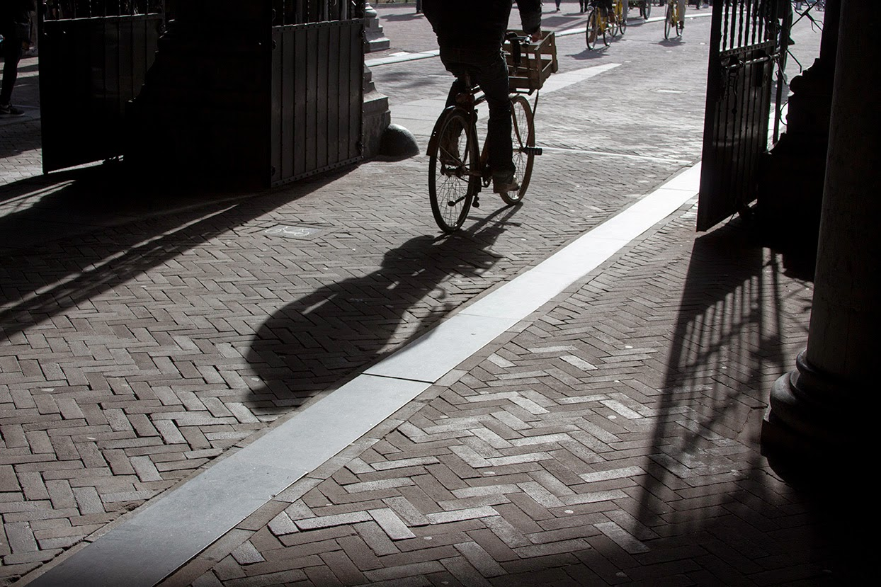 shadow of a man on bicycle, Rijksmuseum, Amsterdam