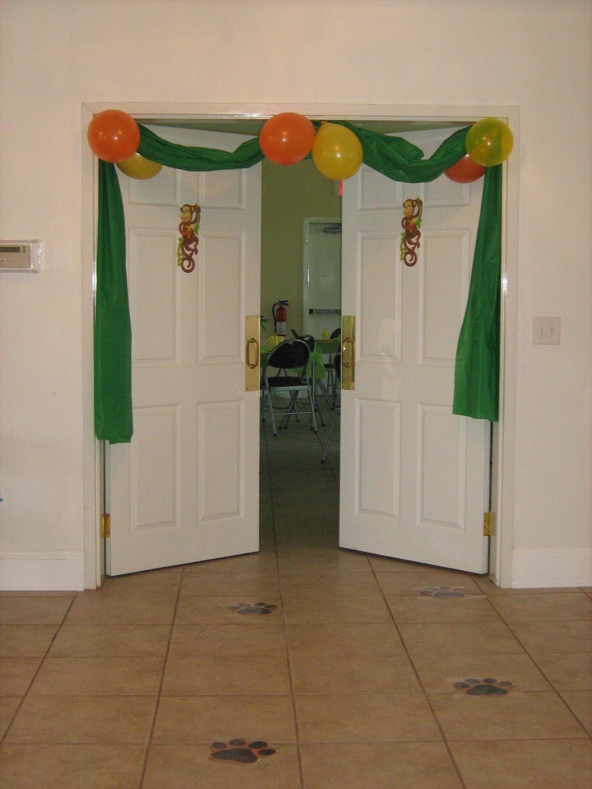For the doorway, we used plastic table clothes and balloons. We were ...