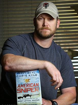 Chris Kyle displays his book.