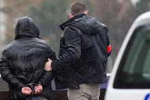 Paris attacks suspect still on run amid 16 arrests in Belgium